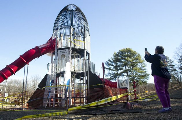 arkansas-democrat-gazettemelissa-sue-gerrits-01252014-pattie-platt-a-50-year-resident-of-north-little-rock-takes-a-photo-of-the-rocket-slide-at-burns-park-that-was-vandalized-over-night-january-25-2014-platt-says-she-plans-to-post-photos-to-a-facebook-page-in-hopes-of-raising-money-for-a-rebuild-so-many-memories-here-platt-said-my-ex-husband-was-one-of-the-first-kids-to-slide-down-the-original-the-slide-that-melted-to-the-ground-was-from-a-revamp-8-years-ago