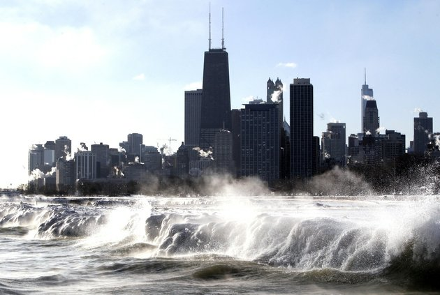 ice-forms-as-waves-crash-along-the-lake-michigan-shore-monday-jan-27-2014-in-chicago-below-zero-high-temperatures-have-returned-to-many-parts-of-the-midwest-bringing-with-it-wind-chills-ranging-from-the-negative-teens-to-40s-school-cancellations-and-sighs-of-resignation-from-residents-who-are-weary-of-bundling-up
