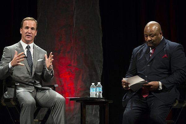 Peyton Manning sneers questions with Keith Jackson at the 2012-2013 All Arkansas Preps Awards Banquet June 1, 2013 at the State Convention Center.