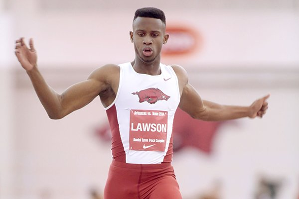 Arkansas sophomore Jarrion Lawson competes in the long jump during a dual meet against Texas on Friday, Jan. 17, 2014, at the Randal Tyson Track Center in Fayetteville.