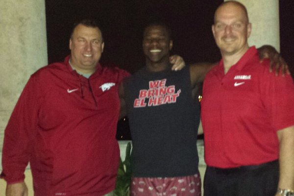 Arkansas defensive end commitment Anthony Brown poses with Coach Bret Bielema and defensive line and specialists coach Rory Segrest during Monday's in-home visit.
