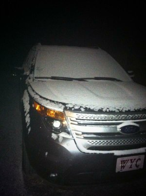Snow covers a vehicle Tuesday morning in Havana in Yell County.