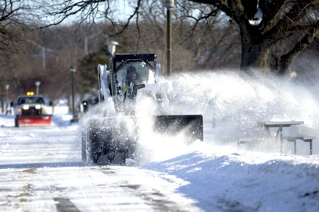 rockford-park-district-employee-taylor-hennelly-operates-a-bobcat-equipped-with-a-snowblower-monday-jan-27-2014-along-the-rock-river-recreation-path-in-rockford-ill-a-second-deep-freeze-in-weeks-locked-the-midwest-in-its-icy-grip-monday-bringing-with-it-wind-chills-ranging-from-the-negative-teens-to-40s