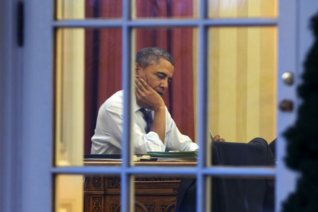 president-barack-obama-works-at-his-desk-in-the-oval-office-of-the-white-house-in-washington-on-monday-ahead-of-tuesday-nights-state-of-the-union-speech