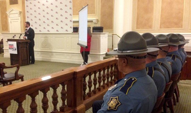 arkansas-highway-and-transportation-department-director-scott-bennett-speaks-tuesday-jan-28-2014-as-a-group-of-state-troopers-gather-at-the-state-capitol-in-little-rock-to-announce-the-toward-zero-deaths-road-safety-campaign