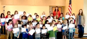 Submitted Photo Members of Decatur Northside Elementary s first grade class display their certificates they received during the honor roll assembly on Jan. 16. In all, 35 first-graders either made the All A s or A-B list for the second quarter.