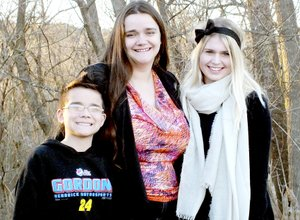 Photo by Cassi Lapp Trine Meisland, 17 (right), is staying at the home of Alisha Hampton (center) in the Highlands while going to Gravette High School as an exchange student from Norway. Manuel Rivera, 9 (left), said he s adapting to no longer being an only child in the home, and getting used to Meisland being around.