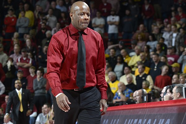 Arkansas head coach Mike Anderson walks back to the bench against Missouri in the second half Tuesday, Jan. 28, 2014 at Bud Walton Arena in Fayetteville. The Razorbacks lost 75-71.