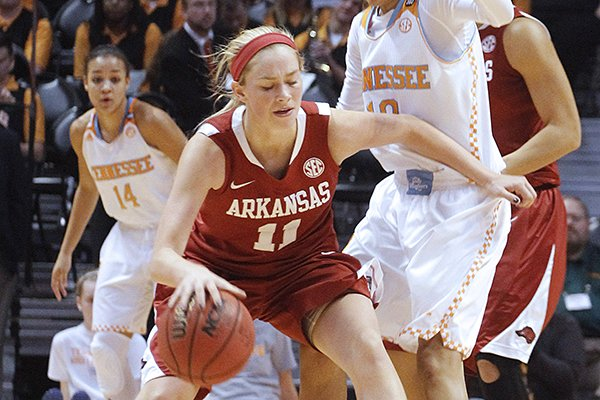Arkansas' Calli Berna, left, drives the ball to the basket against Tennessee's Meighan Simmons in the first half of an NCAA college basketball game, Thursday, Jan. 30, 2014, in Knoxville, Tenn. (AP Photo/Lisa Norman-Hudson)