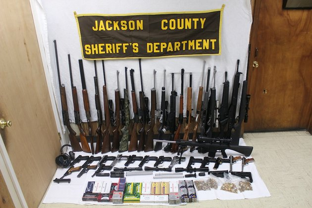 pictured-is-a-sampling-of-the-several-items-the-jackson-county-sheriffs-office-seized-from-69-year-old-donald-bosyters-newport-home-on-jan-14-jackson-county-sheriff-david-lucas-said-investigators-were-informed-that-boyster-had-intended-to-sell-firearms-and-related-accessories-in-his-possession