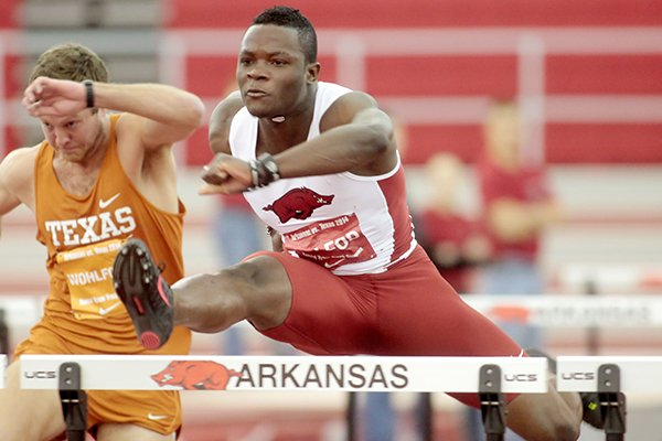 Arkansas freshman Omar McLeod competes in the 60-meter hurdles during a dual meet against Texas on Friday, Jan. 17, 2014, at the Randal Tyson Track Center in Fayetteville.