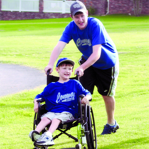will-patterson-pushes-his-brother-ben-at-their-home-in-conway-ben-who-died-in-2007-was-a-member-of-the-braves-a-team-for-special-needs-children-the-team-was-started-by-the-boys-parents-drs-bill-patterson-and-kim-mitchell-fundraising-is-underway-to-build-braves-field-at-an-existing-conway-park-and-the-seating-will-be-called-bens-bleachers