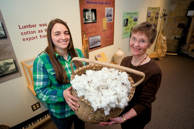 amelia-bowman-left-a-museum-intern-who-is-finishing-her-masters-degree-in-public-history-at-arkansas-state-university-and-twyla-wright-curator-at-the-old-independence-regional-museum-in-batesville-are-shown-with-a-basket-of-cotton-that-is-part-of-earning-a-living-an-exhibit-that-opens-at-the-museumfeb-2