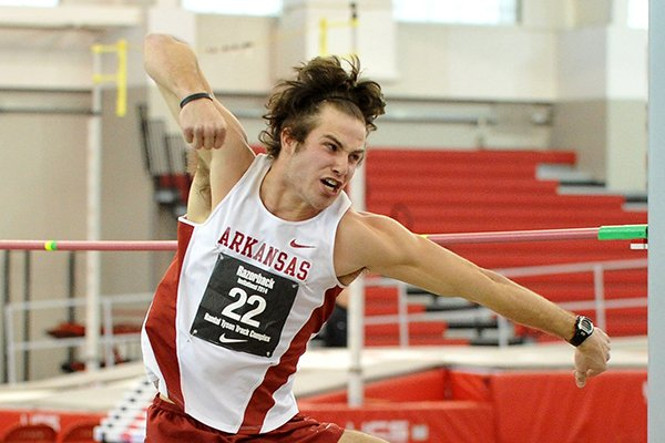 Arkansas heptathlete Kevin Lazas celebrates after clearing a height of 6 feet 6 inches in the high jump during the men's heptathlon Friday evening at the Razorback Invitational at the Randal Tyson Track Complex in Fayetteville. Lazas finished the day in the lead of the men's Heptathlon with 3,277 points.