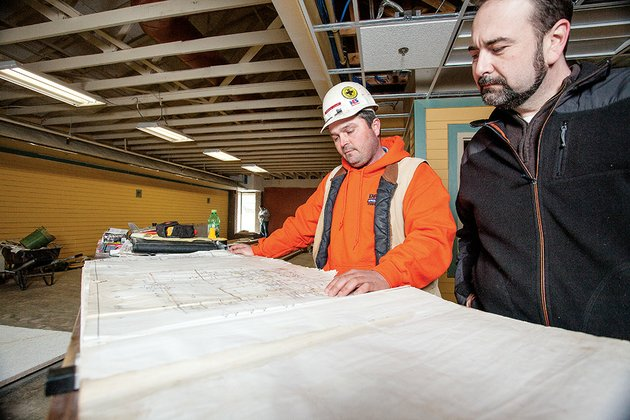 scotty-loyd-left-job-superintendent-for-dayco-construction-inc-of-damascus-and-zac-cothren-director-of-the-cleburne-county-library-in-heber-springs-look-over-the-plans-for-remodeling-and-expanding-the-building-the-22-million-project-scheduled-to-be-completed-in-march-will-more-than-double-the-facilitys-space-the-library-will-become-the-mary-wold-county-library