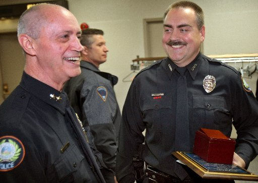 in-this-march-3-2010-photo-little-rock-police-chief-stuart-thomas-left-congratulates-officer-james-tankersley-who-received-the-2009-officer-of-the-year-award-during-the-little-rock-rotary-clubs-18th-annual-police-and-fire-department-awards-city-officials-announced-in-a-statement-on-friday-jan-31-2014-that-thomas-is-retiring-after-serving-eight-years-in-the-position
