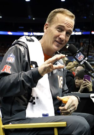 Denver Broncos quarterbacks coach Greg Knapp said quarterback Peyton Manning (above) is successful because of his ability to process what is going on while he's in the pocket.