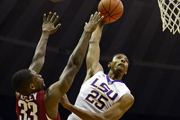 LSU's Jordan Mickey (25) shoots over Arkansas' Moses Kingsley during an NCAA college basketball game on Saturday, Feb. 1, 2014, in Baton Rouge, La. (AP Photo/The Advocate, Catherine Threlkeld)