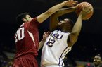 Arkansas' Kikko Haydar fouls LSU's Jarell Martin during an NCAA college basketball game on Saturday, Feb. 1, 2014, in Baton Rouge, La. (AP Photo/The Advocate, Catherine Threlkeld)