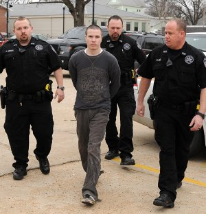 Officers from the Benton County Sheriff's Office escort Zachary Holly into the Benton County Courthouse Annex in Bentonville for a hearing in Judge Brad Karren's courtroom on Friday January 31, 2014. Holly is charged with the November 2012 killing 6-year-old Jersey Bridgeman.