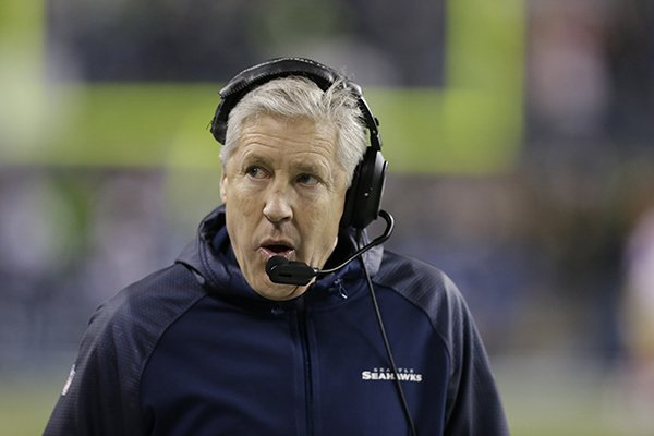 Seattle Seahawks head coach Pete Carroll speaks during the second half of the NFL football NFC Championship game against the San Francisco 49ers Sunday, Jan. 19, 2014, in Seattle. (AP Photo/Elaine Thompson)