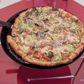AMBER STANLEY-KRUTH/NWA MEDIA House specialties include housemade pizza, such as the spinach pizza w...