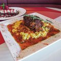 AMBER STANLEY-KRUTH/NWA MEDIA The menu also features fine food entrees, such as pork shank Ossobuco ...