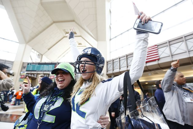 football-fans-cheer-at-the-secaucus-junction-sunday-feb-2-2014-in-secaucus-nj-the-seattle-seahawks-are-scheduled-to-play-the-denver-broncos-in-the-nfl-super-bowl-xlviii-football-game-on-sunday-evening-at-metlife-stadium-in-east-rutherford-nj-ap-photomatt-rourke