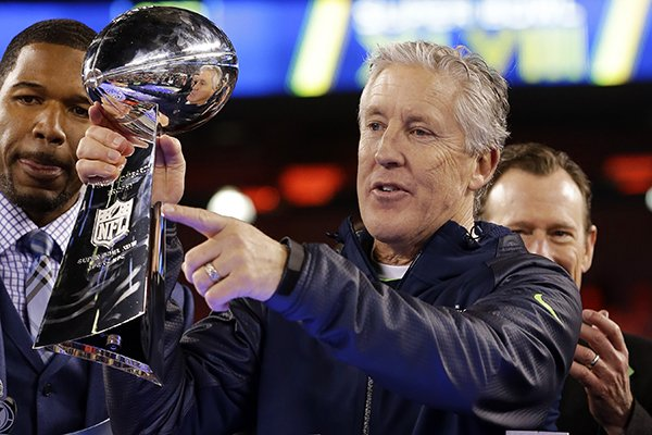 Seattle Seahawks head coach Pete Carroll raises the Vince Lombardi Trophy after the NFL Super Bowl XLVIII football game against the Denver Broncos, Sunday, Feb. 2, 2014, in East Rutherford, N.J. The Seahawks won 43-8. (AP Photo/Matt Slocum)
