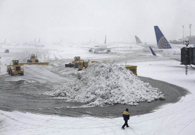 plows-clear-runways-as-snow-falls-at-newark-liberty-international-airport-monday-feb-3-2014-in-newark-nj-air-traffic-is-disrupted-in-ohio-the-mid-atlantic-and-the-northeast-as-another-winter-storm-bears-down-on-the-eastern-us-only-a-day-after-temperatures-soared-into-the-50s