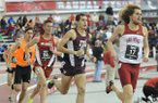 Arkansas senior Raymond Joseph (17) leads the field going into the final lap of the college mile during the Razorback Invitational Saturday, Feb. 1, 2014, at the Randal Tyson Track Center in Fayetteville.