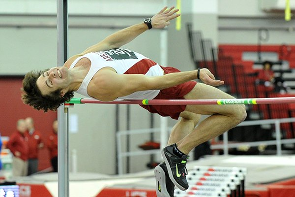 Arkansas heptathlete Kevin Lazas clears the bar with a height of 6 feet 6 inches in the high jump of the men's heptathlon Friday evening at the Razorback Invitational at the Randal Tyson Track Center in Fayetteville.