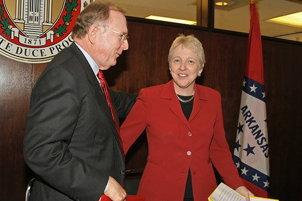 Fomer University of Arkansas chancellor John A.White talks with then-women's athletics director Bev Lewis on Thursday, Nov. 15, 2007 in Fayetteville.