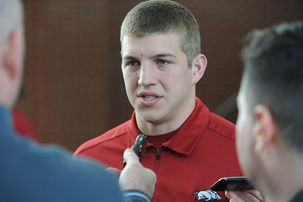 Rafe Peavey, a quarterback from Bolivar, Mo., answers questions during a National Signing Day ceremony Wednesday, Feb. 5, 2014, at the university's football complex.
