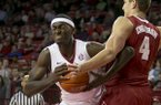 Arkansas forward Bobby Portis, left, drives to the basket against Alabama center Carl Engstrom (4) during the first half of an NCAA college basketball game on Wednesday, Feb. 5, 2014, in Fayetteville, Ark. (AP Photo/Gareth Patterson)