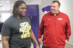 Arkansas Razorbacks head football coach Bret Bielema talks with El Dorado High School's Bijhon Jackson, a Razorback commit, during a visit at El Dorado High School on Thursday, Jan. 23, 2014.