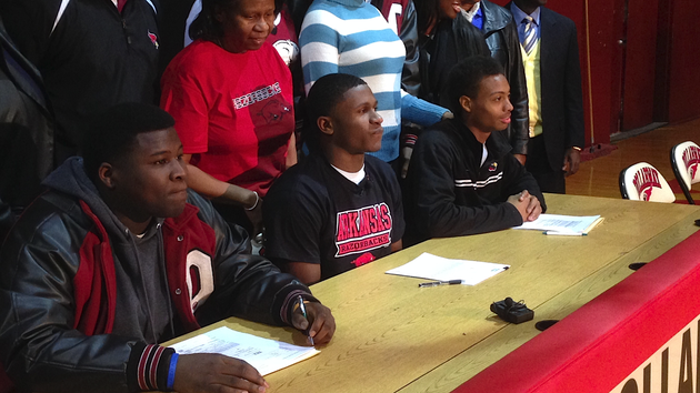 flanked-by-teammates-pine-bluff-dollarway-athlete-josh-liddell-center-waits-at-a-signing-ceremony-wednesday-feb-5-2013-in-the-dollarway-high-school-gym-liddell-signed-with-arkansas