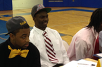 North Little Rock running back Juan Day smiles prior to a signing ceremony where he made his commitment to Arkansas official on Wednesday morning. He's flanked by Kavin Alexander (left), who signed with Arkansas-Pine Bluff and Josh Williams (right), who signed with Central Oklahoma.
