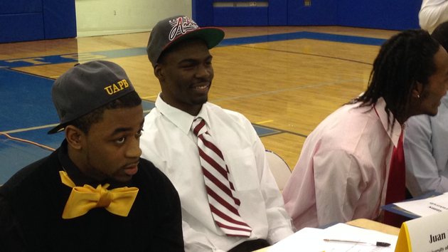 north-little-rock-running-back-juan-day-smiles-prior-to-a-signing-ceremony-where-he-made-his-commitment-to-arkansas-official-on-wednesday-morning-hes-flanked-by-kavin-alexander-left-who-signed-with-arkansas-pine-bluff-and-josh-williams-right-who-signed-with-central-oklahoma