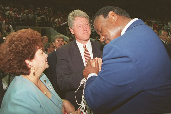 arkansas-coach-nolan-richardson-right-spends-an-emotional-moment-with-his-wife-rose-and-president-bill-clinton-after-an-ncaa-championship-victory-on-monday-april-4-1994-in-charlotte-nc