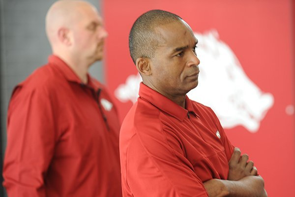 Randy Shannon, Arkansas assistant coach and linebackers coach, listens during a National Signing Day ceremony Wednesday, Feb. 5, 2014, at the university's football complex.