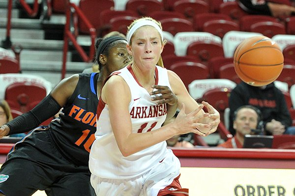 Arkansas point guard Calli Berna has the ball knocked out of her hands by Florida guard Jaterra Bonds as she tries to drive to the hoop during the first half of Thursday night's game at Bud Walton Arena in Fayetteville.