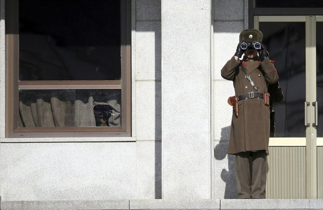 a-north-korean-soldier-looks-at-southern-side-through-a-pair-of-binoculars-at-the-border-village-of-panmunjom-south-korea-which-has-separated-the-two-koreas-since-the-korean-war-on-thursday-feb-6-2014-north-korea-threatened-thursday-to-cancel-a-reunion-later-this-month-of-korean-war-divided-families-because-of-forthcoming-us-south-korean-military-drills-causing-frustration-in-seoul-only-one-day-after-the-rivals-agreed-on-dates-for-the-emotional-meetings