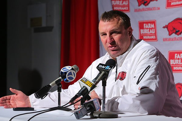 Arkansas football coach Bret Bielema talks with the media before a private Signing Day in the Rock event Thursday evening in Little Rock.