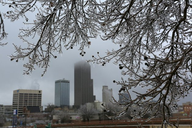 the-little-rock-skyline-is-framed-by-the-ice-covered-branches-of-a-small-tree-along-i-30-in-little-rock-tuesday-feb-4-2014