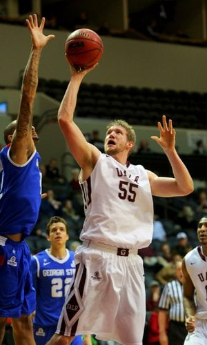 UALR's Gus Leeper (55) gets his shot blocked by Georgia State's Curtis Washington (left) during the first half of the Trojans' 68-57 loss to the Panthers on Thursday at the Jack Stephens Center in Little Rock.