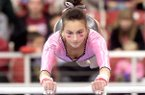Arkansas junior Stephani Canizaro competes on the beam on Friday, Feb. 7, 2014, during a meet against Louisiana State at Barnhill Arena in Fayetteville. Canizaro scored a 9.825 in the event.