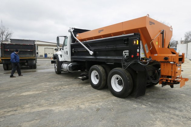 the-arkansas-highway-and-transportation-departments-newest-belly-plow-deicing-truck-is-driven-into-place-at-the-departments-sand-and-salt-facility-in-little-rock-ark-friday-feb7-2014-a-department-official-said-the-center-mounted-blade-under-the-truck-is-more-effective-in-removing-ice-from-roadways-than-a-conventional-front-mounted-blade