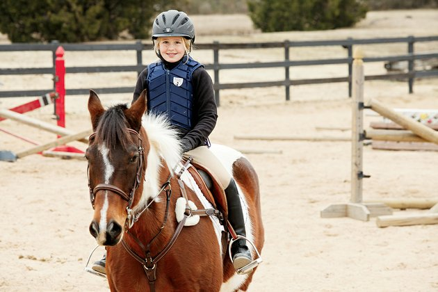 leah-goff-9-of-conway-takes-a-riding-lesson-at-caney-creek-farm-she-participates-in-hunterjumper-events-and-was-named-high-point-rider-two-years-in-a-row-which-her-trainer-called-amazing-leahs-mother-april-goff-said-leah-always-drew-pictures-of-horses-and-fell-in-love-with-riding-when-she-was-6