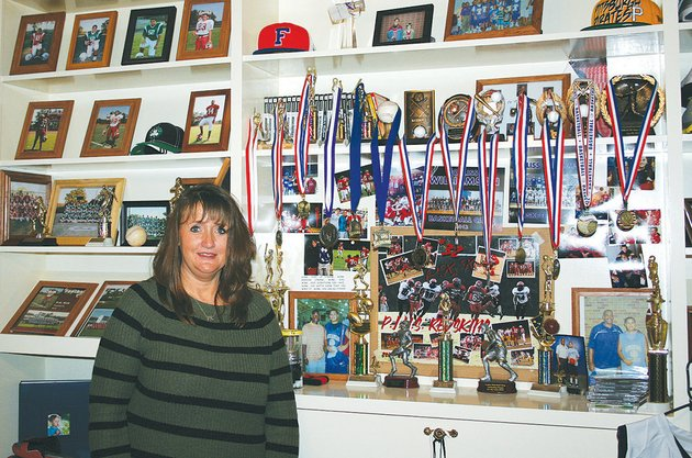 kristi-kirk-stands-near-a-wall-in-her-son-pks-room-that-showcases-his-many-athletic-achievements-the-wall-remains-exactly-as-he-left-it-on-a-warm-day-in-june-2013-the-pocahontas-student-died-in-a-car-accident-prior-to-starting-his-senior-year-in-high-school